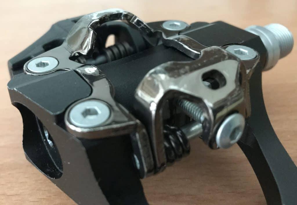 tension adjustment bolt on pedal cleat bracket