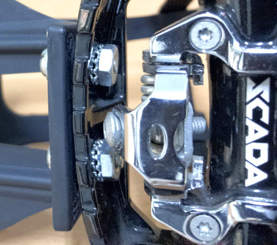 close up of toe pedal cage nuts