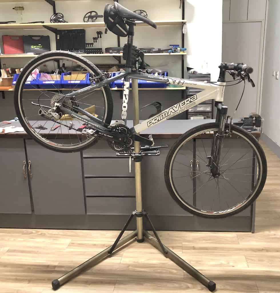 bike suspended on bike repair stand