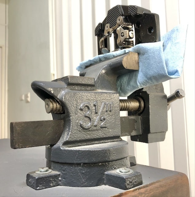 pedal in a vise ready to be worked on